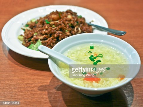 Egg soup and black fried rice : Stock Photo