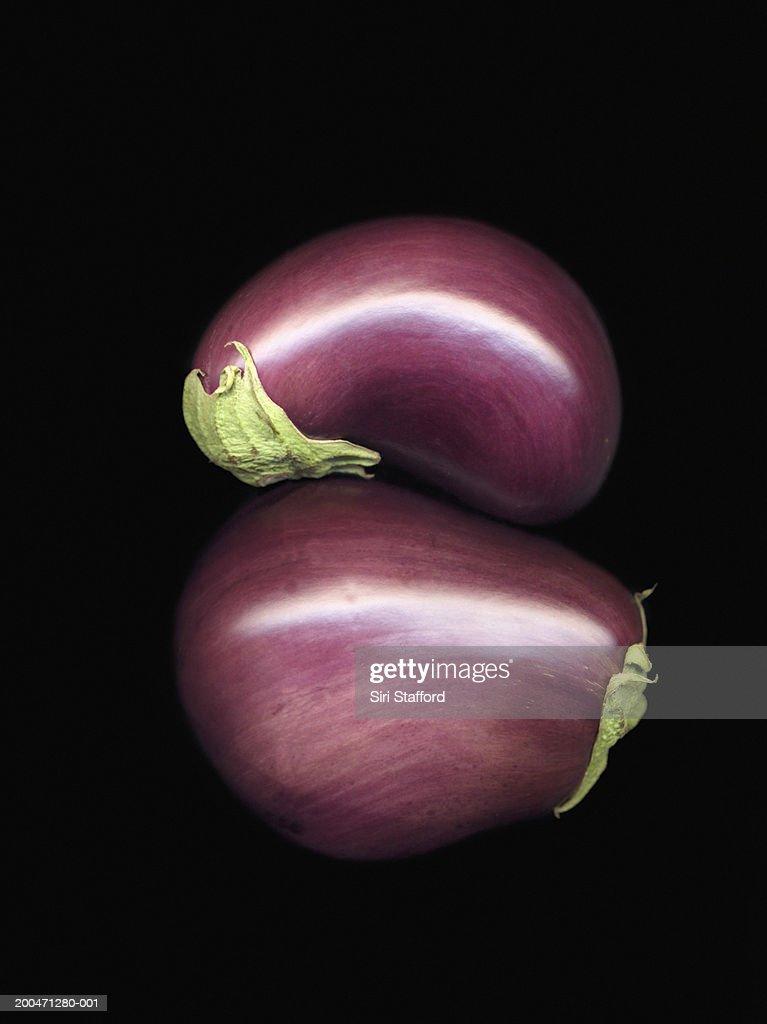 Eggplants (Solanum melongena) on black background : Stock Photo