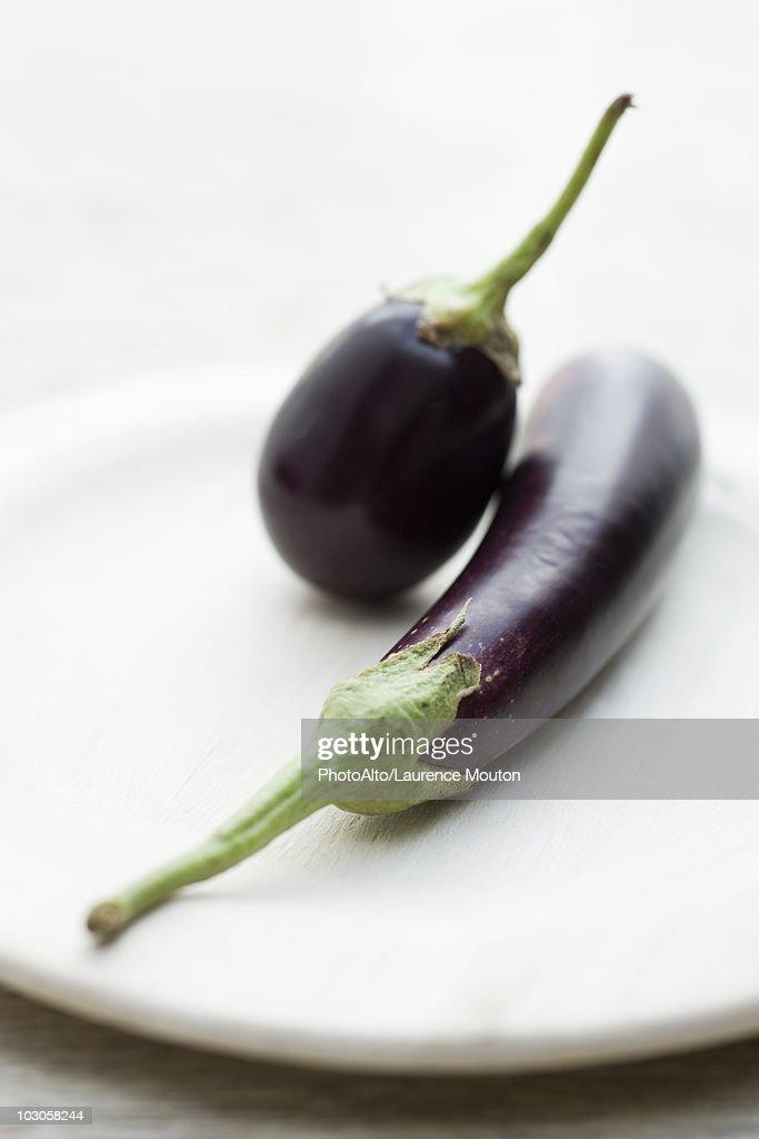 Eggplants on plate : Stock Photo
