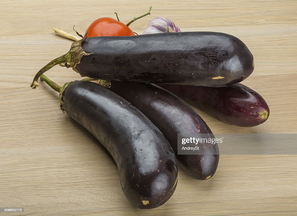 Eggplants on the board : Stock Photo