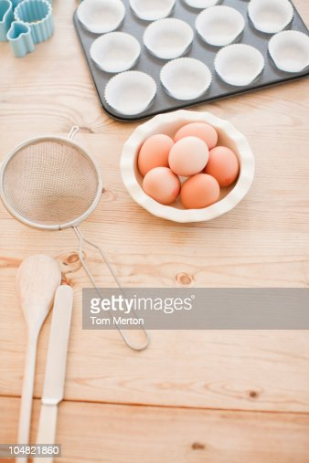 Eggs and baking supplies on table : Stock Photo