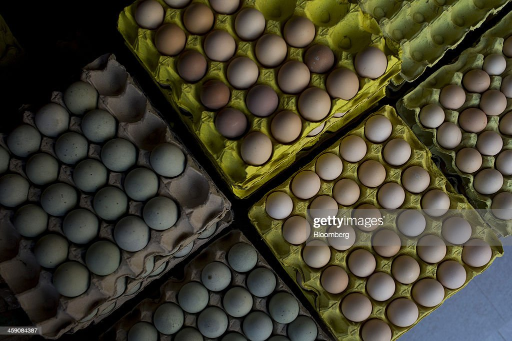 Eggs are displayed for sale at a stall at the Shekou wet market in Shenzhen, China, on Thursday, Dec. 19, 2013. Two of Chinas three biggest securities firms predict the central bank will refrain from using open-market operations to inject funds this week as policy makers seek to rein in debt and contain inflation. Photographer: Brent Lewin/Bloomberg via Getty Images