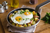 Fried eggs with roasted potatoes and bacon lardons