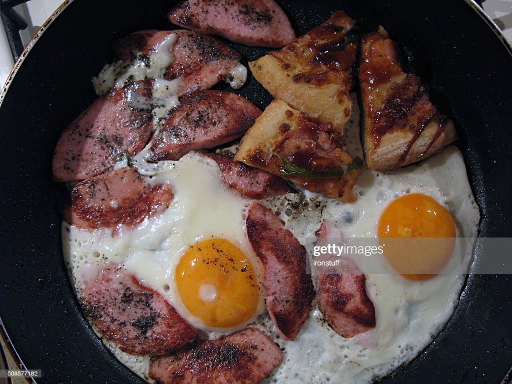 Eggs fried with sausages and pepper : Stock Photo