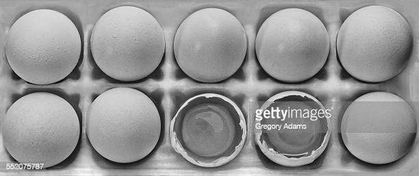 Eggs from above, broken and whole in B&W