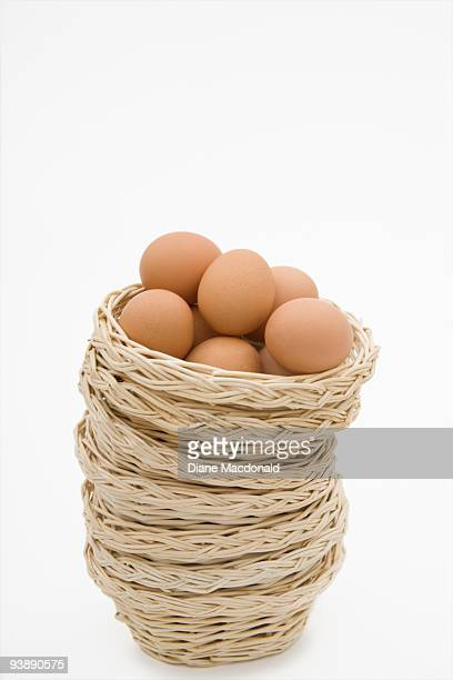 Eggs in a stack of baskets