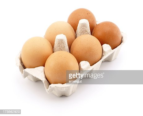 Eggs in carton isolated on white