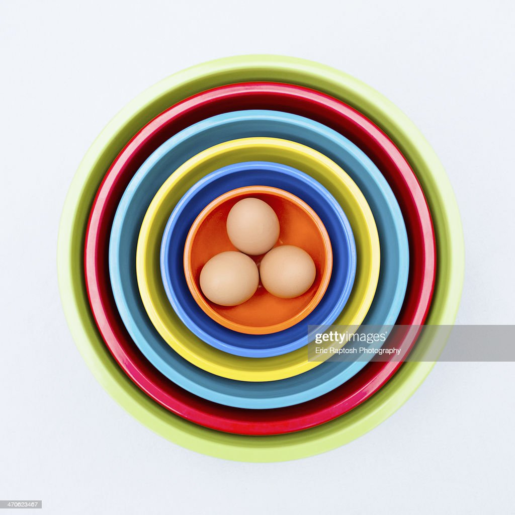 Eggs in colorful nesting bowls