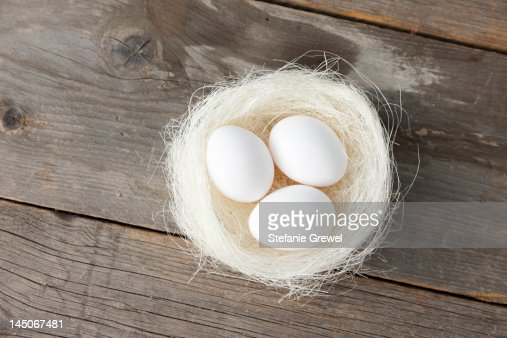 Eggs in nest on wooden counter : Stock Photo