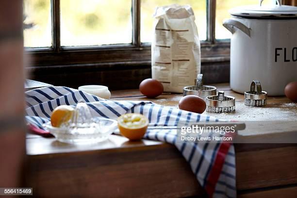 Eggs, lemon and flour on kitchen counter