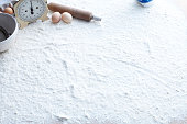 Eggs, rolling pin and floured surface