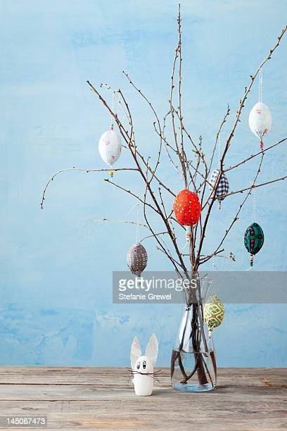 Egg-shaped decorations on branches