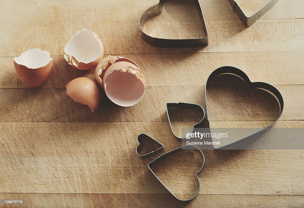 Eggshells and heart shaped cookie cutters : Stock Photo