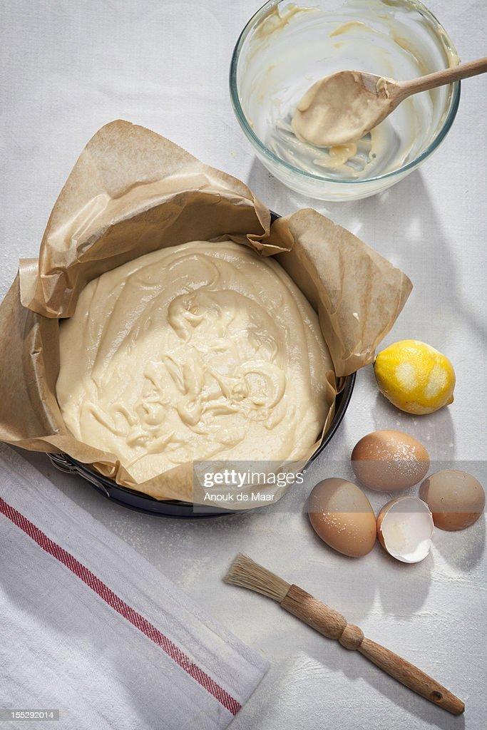 Eggshells, flour, lemon and batter : Stock Photo