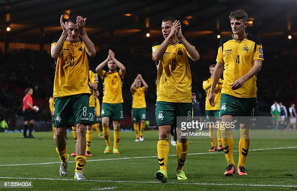 Egidijus Vaitkunas Mindaugas Grigaravioius and Edvinas Girdvainis of Lithuania applaud the fans during the FIFA 2018 World Cup Qualifier between...