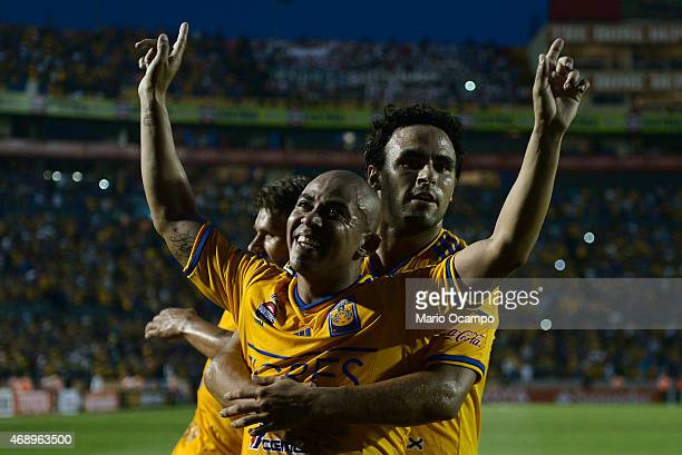 Egidio Arevalo of Tigres celebrates with teammate Enrique Esqueda after scoring his team's first goal during a group 6 match between Tigres UANL and...