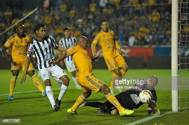Egidio Arevalo of Tigres tries to score over Oscar 'Conejo' Perez goalkeeper of Pachuca during a quarterfinal second leg match between Tigres UANL...
