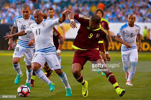 Egidio Arevalo of Uruguay battles for the ball with Jose Salomon Rondon of Venezuela during a group C match between Uruguay and Venezuela at Lincoln...