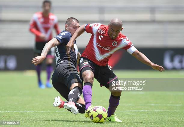 Egidio Arevalo of Veracruz vies for the ball with Nicolas Castillo of Pumas during their Mexican Clausura 2017 tournament football match at the...