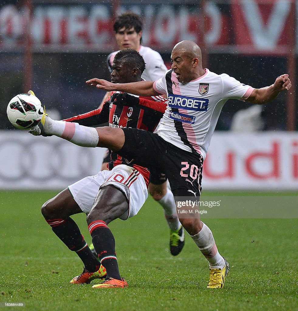 Egidio Arevalo Rios (R) of Palermo and Mbaye Niang of Milan compete for the ball during the Serie A match between AC Milan and US Citta di Palermo at San Siro Stadium on March 17, 2013 in Milan, Italy.