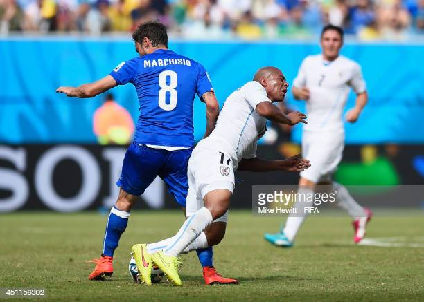 Egidio Arevalo Rios of Uruguay is tackled by Claudio Marchisio of Italy which ends up a red card to Marchisio during the 2014 FIFA World Cup Brazil...