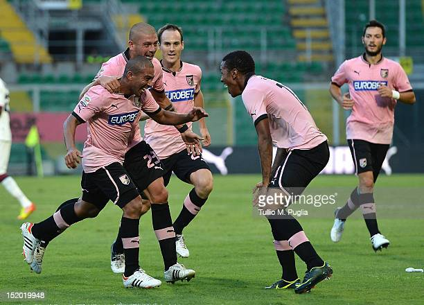 Egidio Arevalos Rios celebrates with teammates after scoring the opening goal during the Serie A match between US Citta di Palermo and Cagliari...