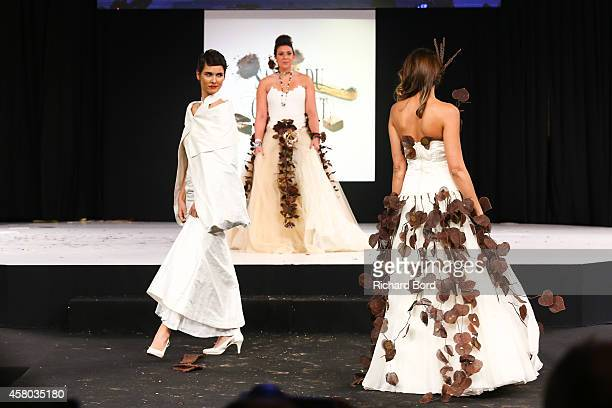 Eglantine Emeye Marion Bartoli and Valerie Begue walk the runway during the Fashion Chocolate show at Salon du Chocolat at Parc des Expositions Porte...