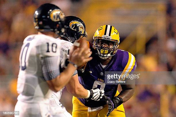 Ego Ferguson of the LSU Tigers pressures Colin Reardon of the Kent State Golden Flashes during a game at Tiger Stadium on September 14 2013 in Baton...