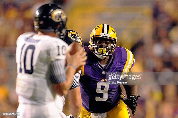 Ego Ferguson of the LSU Tigers rushes the passer during a game against the Kent State Golden Flashes at Tiger Stadium on September 14 2013 in Baton...