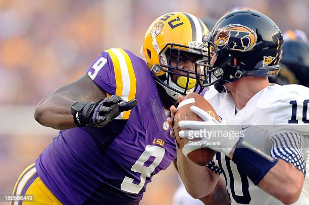 Ego Ferguson of the LSU Tigers sacks Colin Reardon of the Kent State Golden Flashes during a game at Tiger Stadium on September 14 2013 in Baton...