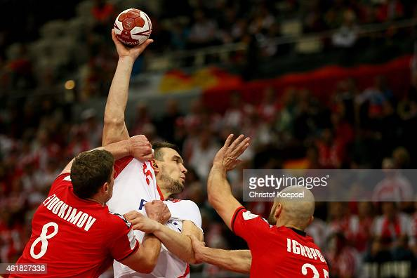 Egor Evdokimov of Russia and Konstantin Igropulo of Russia defend against Bartosz Jurecki of Poland during the IHF Men's Handball World Championship...