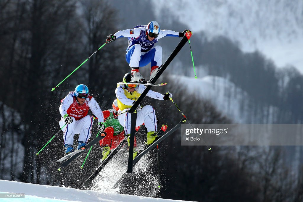 Egor Korotkov of Russia leads from Jonathan Midol of France, Jean Frederic Chapuis (L) of France and <a gi-track='captionPersonalityLinkClicked' href=/galleries/search?phrase=Armin+Niederer&family=editorial&specificpeople=5670393 ng-click='$event.stopPropagation()'>Armin Niederer</a> of Switzerland during the Freestyle Skiing Men's Ski Cross Semi Finals on day 13 of the 2014 Sochi Winter Olympic at Rosa Khutor Extreme Park on February 20, 2014 in Sochi, Russia.