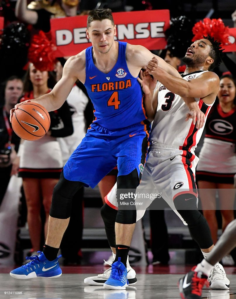 Egor Koulechov #4 of the Florida Gators commits an offensive foul against Juwan Parker #3 of the Georgia Bulldogs at Stegeman Coliseum on January 30, 2018 in Athens, Georgia.