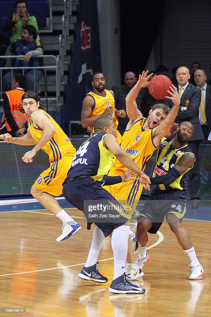 Egor Vyaltsev of BC Khimki Moscow competes with Bo McCalebb and Mike Batiste of Fenerbahce Ulker during the 20122013 Turkish Airlines Euroleague Top...