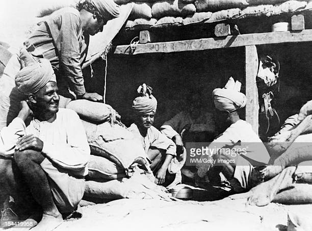 Egypt And Palestine 1914 1918 1917 The Advance across the Desert Men of the 123rd Outram's Rifles sitting cross legged outside their dugout December...