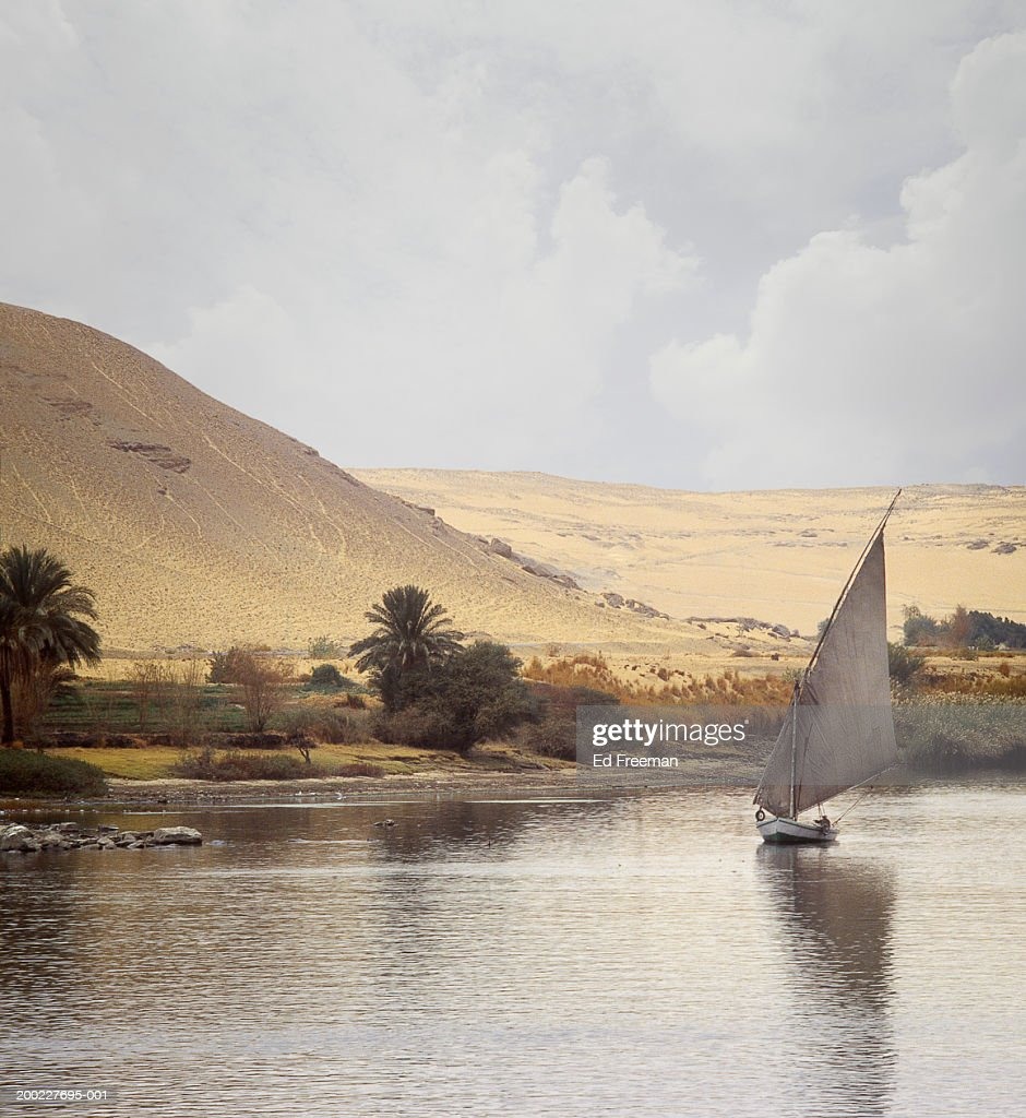 Egypt, Aswan, man sailing felucca on River Nile