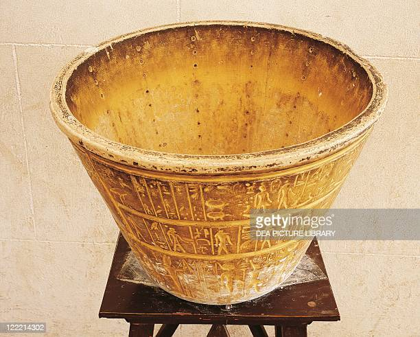 Egypt Cairo Pharaonic Village Water clock copy of a conical alabaster vase with columns of 12 holes Time was calculated by draining out of the water...