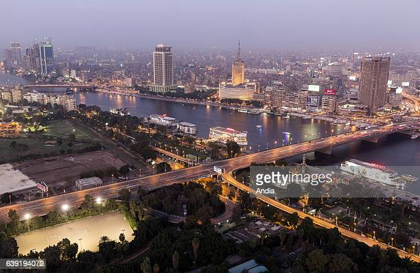 Egypt Cairo the Nile River and the city viewed at night from the Cairo Tower in the Zamalek district on Gezira Island