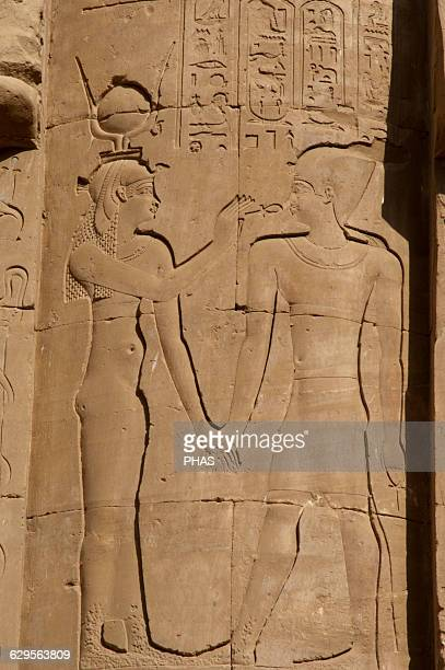 Egypt Edfu Temple of Horus Relief depicting an egyptian deity giving the key of life ankh to the Pharaoh