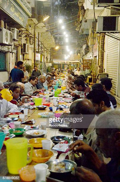 CAIRO Egypt People eat a fastbreaking dinner called Iftar during the Ramadan fasting month on Aug 8 2011