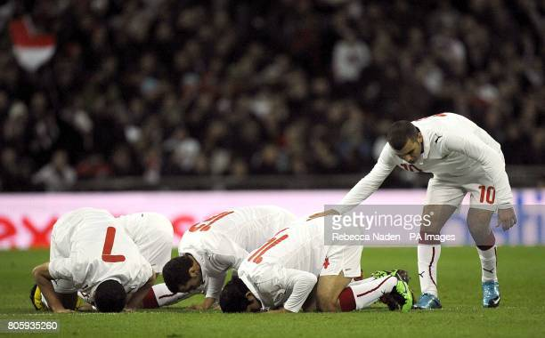 Egypt players celebrate after Mohamed Zidan scores their side's first goal of the game