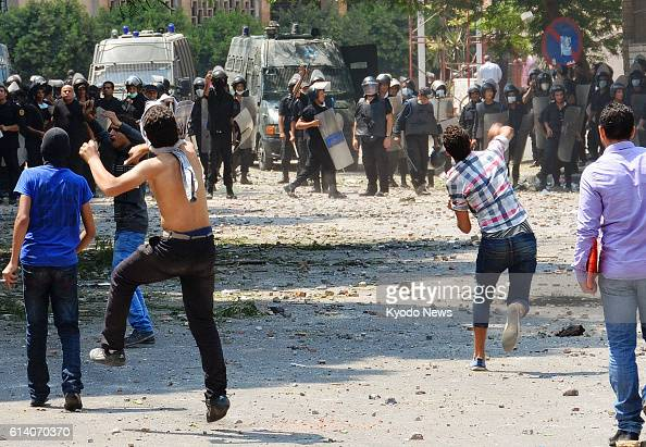 CAIRO Egypt Protesters hurl stones at police officers near the US Embassy in Cairo on Sept 13 as people demonstrate for the third straight day...