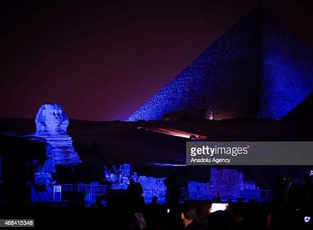 Egypt pyramids are illuminated in blue to support Autism Speakss global annual Light it up Blue campaign to celebrate World Autism Awareness Day and...