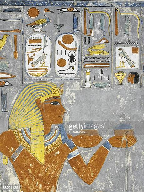 Egypt Thebes Luxor Valley of the Kings Tomb of Horemheb Vestibule Mural paintings Pharaoh's votive offering and cartouches