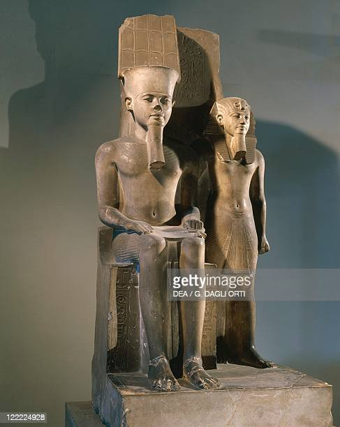 Egypt Thebes Statuary group representing Tutankhamun seated on the throne and Amun standing at his side the royal names were substituted with the...