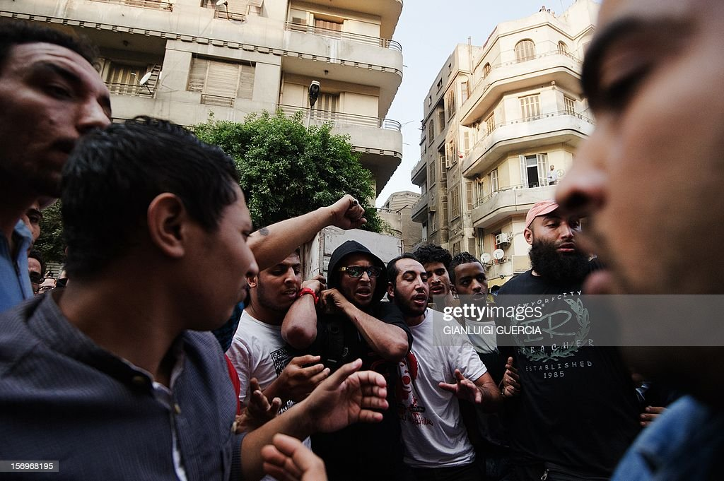 Egyptian Activists and April 6 movement members carry the coffin of Gaber Salah, an activist who died overnight after he was critically injured in clashes near Cairo's Tahrir Square last week, during his funeral at Tahrir square on November 26, 2012 in Cairo. Salah, a member of the April 6 movement known by his nickname 'Jika', was hurt in confrontations between police and protesters on Mohammed Mahmud street where protesters had been marking the first anniversary of deadly clashes. AFP PHOTO/GIANLUIGI GUERCIA
