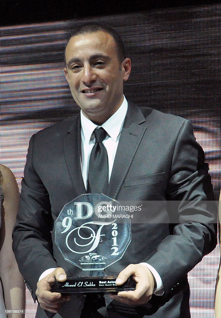 Egyptian actor Ahmed Al Sakka poses after receiving a lifetime achievement award during the Dear Guest (DG) Egyptian English magazine's yearly event on January 19, 2013 in Cairo. AFP PHOTO AMRO MARAGHI