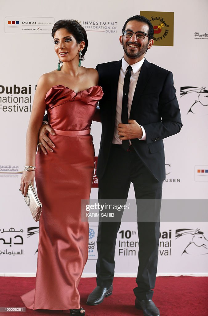 Egyptian actor Ahmed Helmi posses for a photograph with his wife actress Mona Zaki as they attend the closing ceremony of the 10th Annual Dubai International Film Festival in the Gulf emirate of Dubai on December 13, 2013.