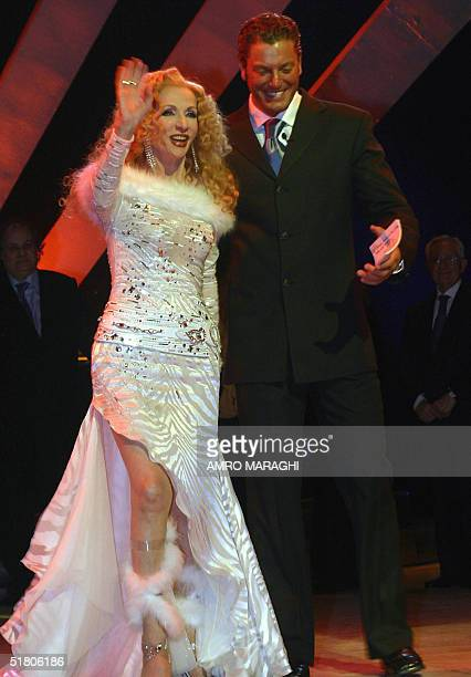 Egyptian actor Tamer Hagras presents Lebanese legendary singer Sabah at the opening night of Cairo's 28th International Film Festival at the Opera...