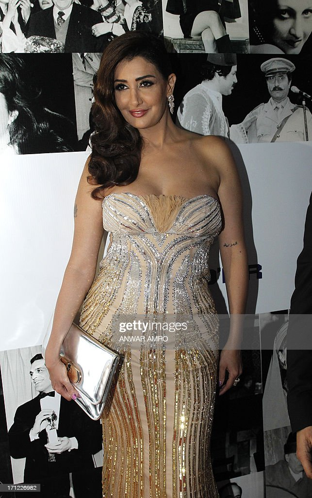 Egyptian actress Ghada Abdel Razek arrives for the 13eme Murex D'or Festival taking place at the Casino Du Liban, north of the capital Beirut, on June 23, 2013. AFP PHOTO/ANWAR AMRO